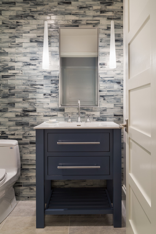 Mid-sized trendy 3/4 ceramic tile and blue tile porcelain tile and gray floor walk-in shower photo in Salt Lake City with furniture-like cabinets, blue cabinets, a one-piece toilet, white countertops, blue walls, an integrated sink, quartz countertops and a hinged shower door