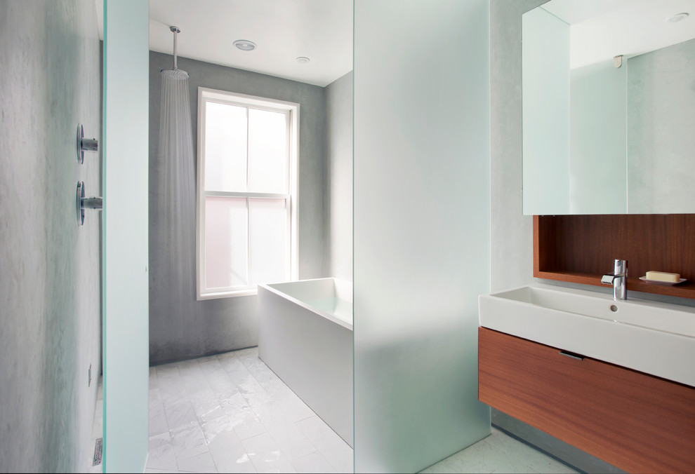 Inspiration for a contemporary master gray tile bathroom remodel in Boston with a trough sink, flat-panel cabinets, medium tone wood cabinets, gray walls and a hinged shower door