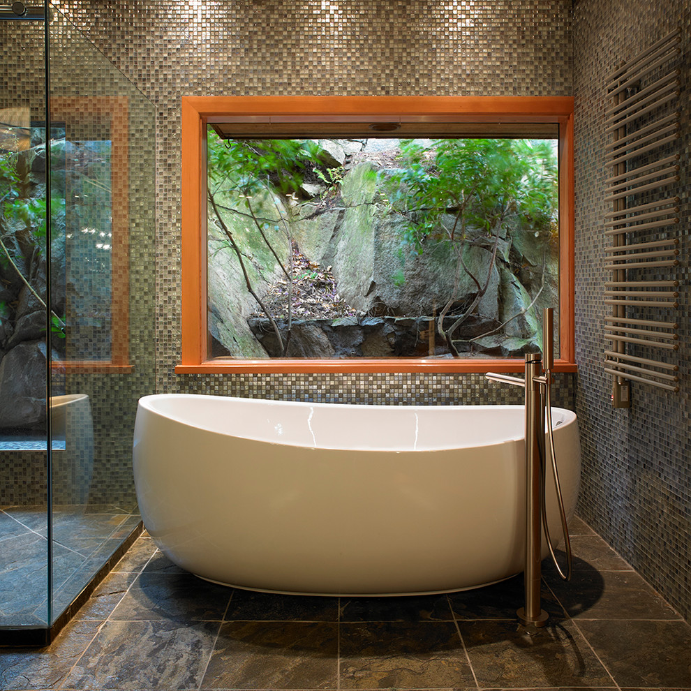 Inspiration for a rustic mosaic tile freestanding bathtub remodel in Vancouver