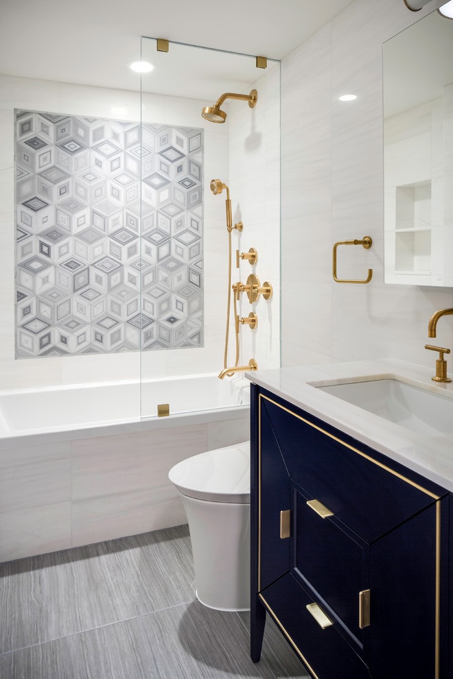 Bathroom - contemporary beige tile and gray tile gray floor bathroom idea in New York with furniture-like cabinets, beige walls, an undermount sink and beige countertops