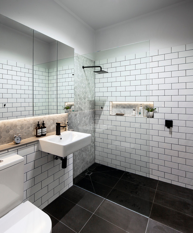 Inspiration for a contemporary white tile and subway tile walk-in shower remodel in Melbourne with a wall-mount sink