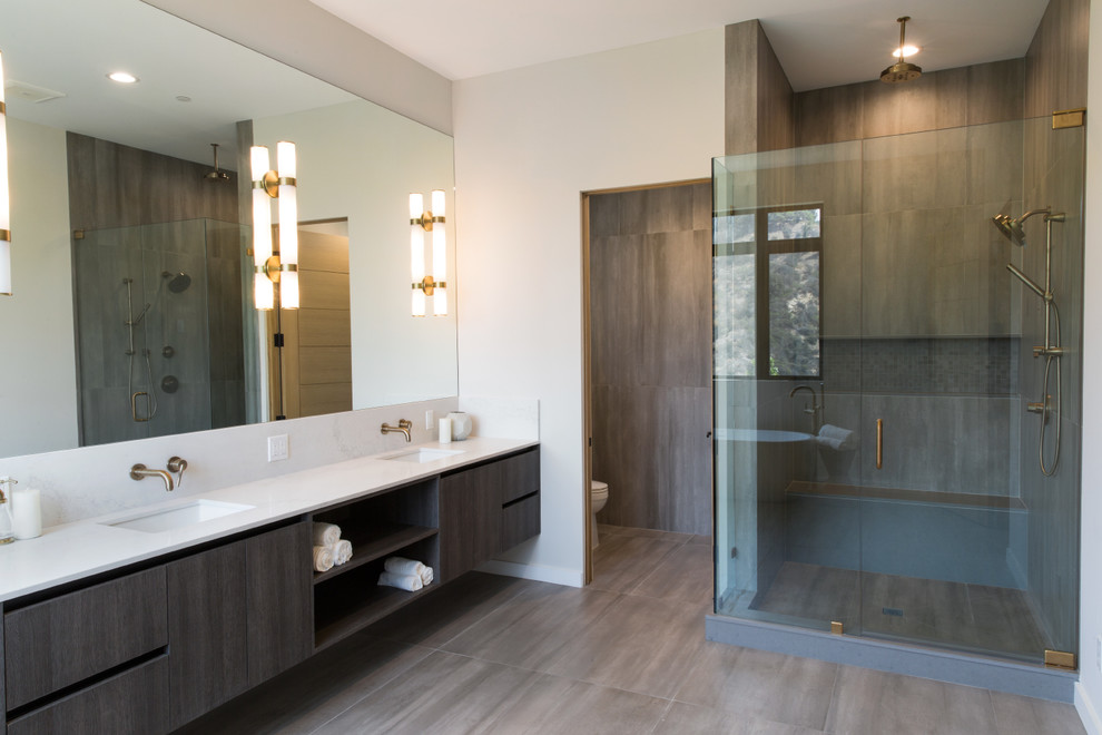 Example of a large minimalist master white tile and ceramic tile ceramic tile and gray floor bathroom design in Los Angeles with flat-panel cabinets, light wood cabinets, white walls, an undermount sink, marble countertops, a hinged shower door and white countertops