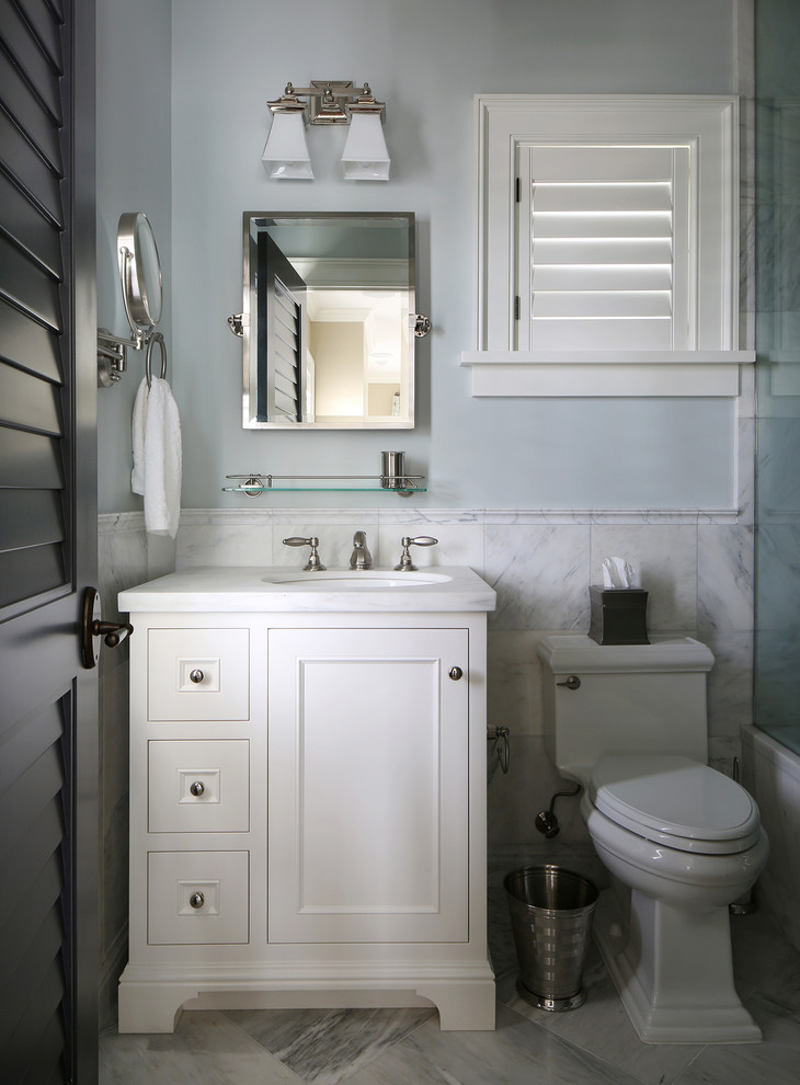 Inspiration for a tropical alcove bathtub remodel in Tampa with an undermount sink and a one-piece toilet