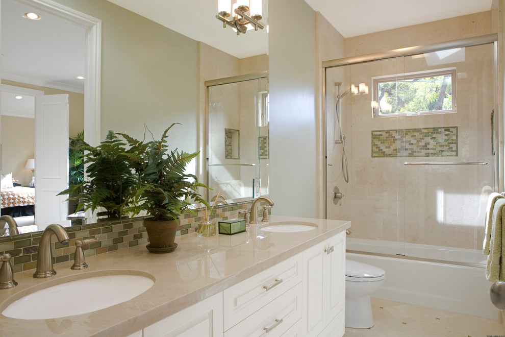 Transitional beige tile bathroom photo in San Francisco with an undermount sink, raised-panel cabinets, white cabinets and beige countertops