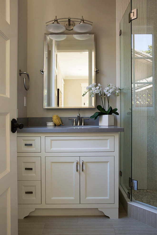 Inspiration for a transitional bathroom remodel in San Francisco with an undermount sink, recessed-panel cabinets, white cabinets, beige walls and gray countertops