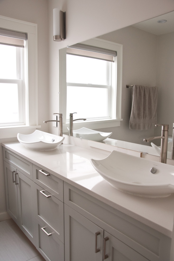 Mid-sized trendy master white tile and ceramic tile ceramic tile corner shower photo in San Francisco with a vessel sink, shaker cabinets, gray cabinets, quartz countertops, a one-piece toilet and gray walls