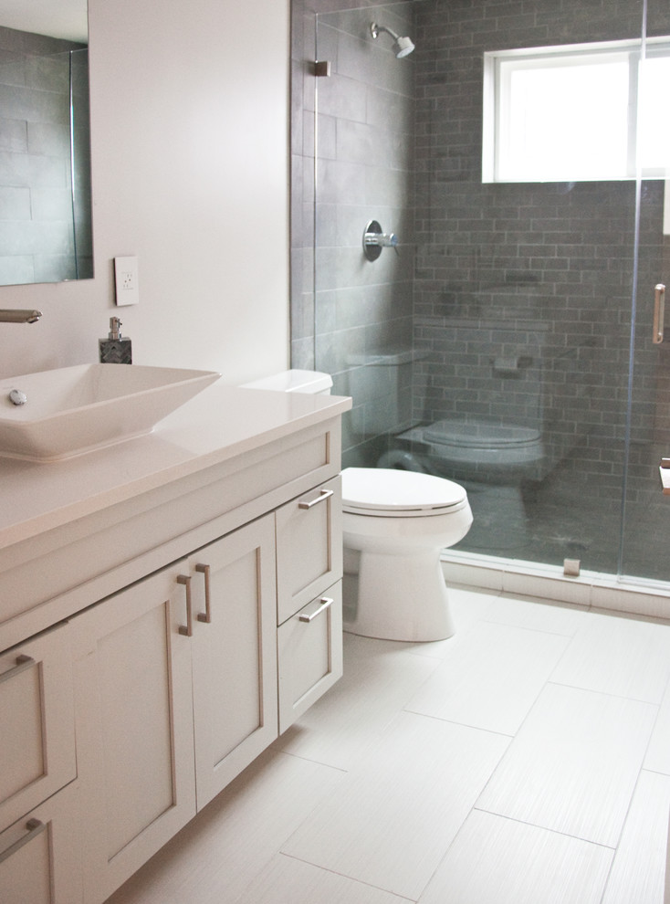 Alcove shower - mid-sized contemporary 3/4 white tile and ceramic tile ceramic tile alcove shower idea in San Francisco with a vessel sink, shaker cabinets, gray cabinets, quartz countertops, a one-piece toilet and gray walls