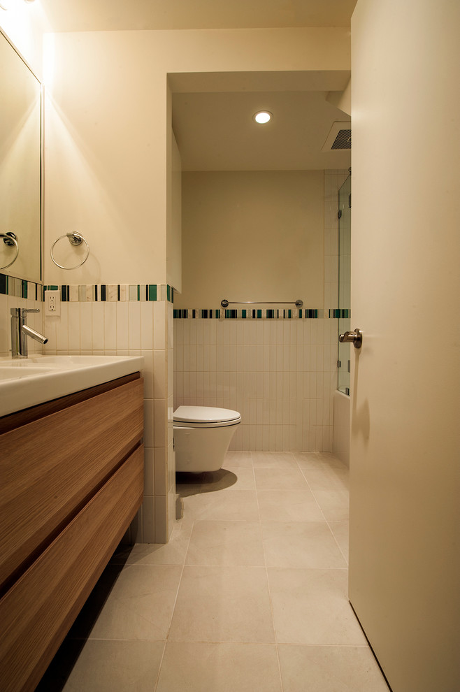Drop-in bathtub - mid-sized mid-century modern 3/4 white tile and subway tile ceramic tile drop-in bathtub idea in Vancouver with an integrated sink, flat-panel cabinets, medium tone wood cabinets, solid surface countertops and white walls