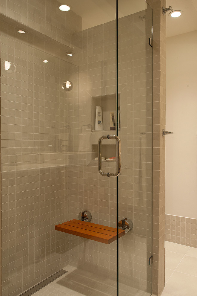 Example of a mid-sized mid-century modern master beige tile and ceramic tile ceramic tile walk-in shower design in Vancouver with a vessel sink, flat-panel cabinets, medium tone wood cabinets, quartz countertops, a two-piece toilet and white walls
