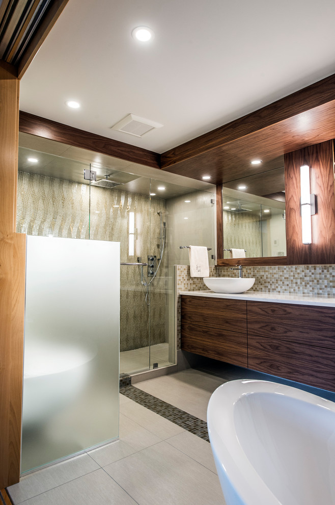 Inspiration for a mid-sized modern master multicolored tile and mosaic tile porcelain tile and gray floor bathroom remodel in Vancouver with flat-panel cabinets, dark wood cabinets, a wall-mount toilet, white walls, a vessel sink, quartz countertops and a hinged shower door