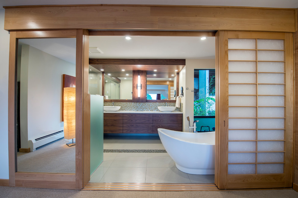 Example of a mid-sized minimalist master multicolored tile and mosaic tile porcelain tile and gray floor bathroom design in Vancouver with flat-panel cabinets, dark wood cabinets, a wall-mount toilet, white walls, a vessel sink, quartz countertops and a hinged shower door