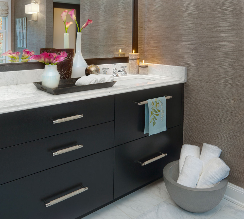 Bathroom - transitional bathroom idea in New York with flat-panel cabinets and black cabinets