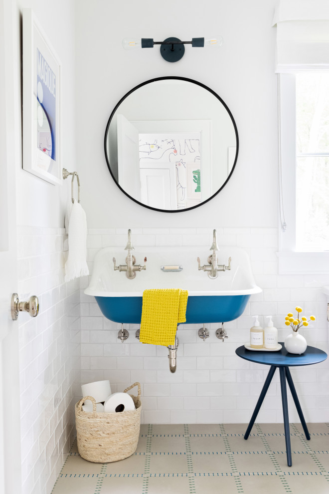 Mid-sized trendy kids' white tile and ceramic tile cement tile floor and beige floor bathroom photo in New York with a one-piece toilet, white walls and a trough sink