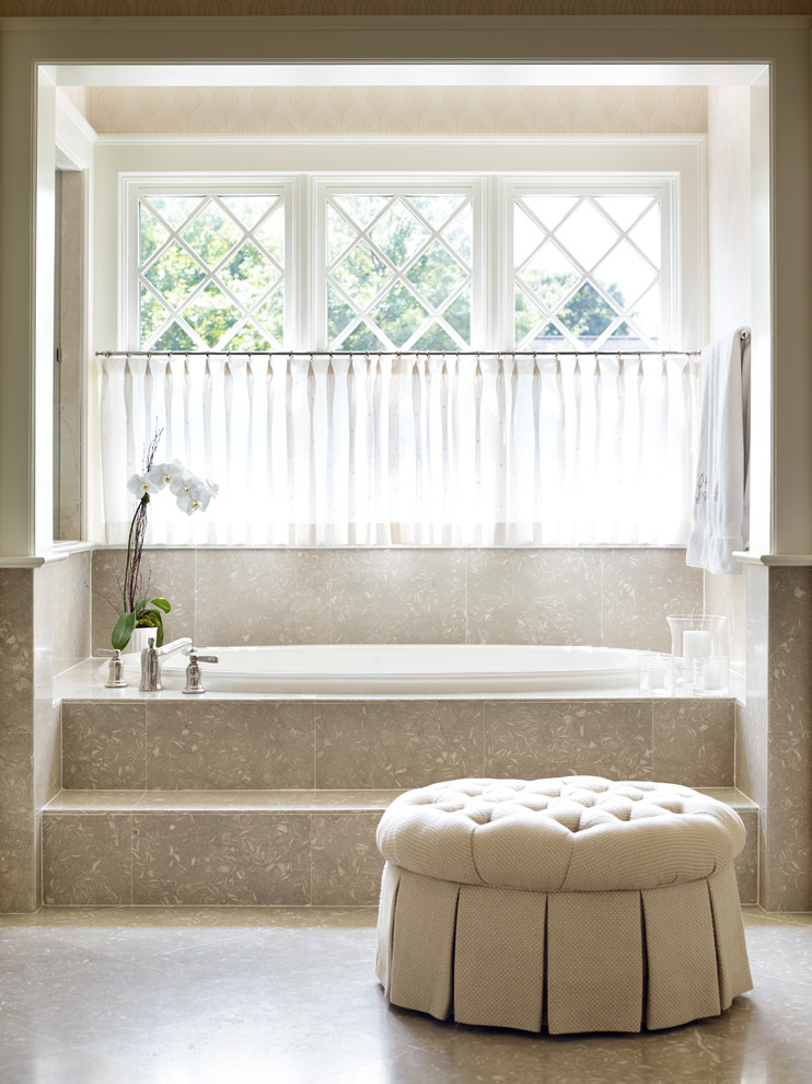 Mid-sized elegant master beige tile and limestone tile limestone floor bathroom photo in Charlotte with beige walls and recessed-panel cabinets
