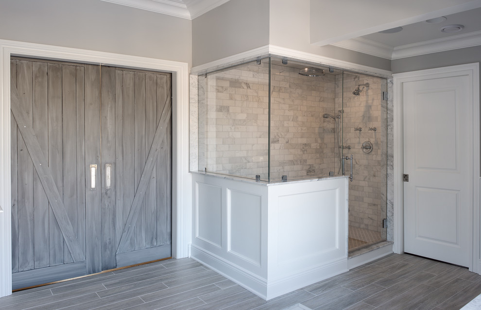 Large transitional gray tile and subway tile ceramic tile bathroom photo in New York with gray walls