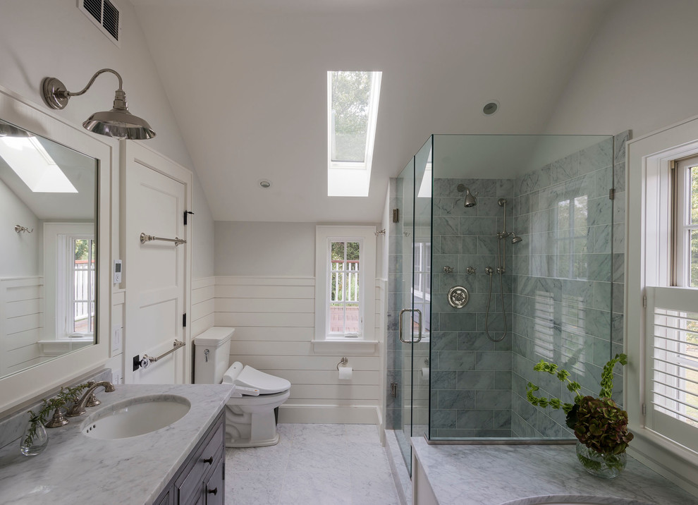 Corner shower - cottage master corner shower idea in New York with an undermount sink, raised-panel cabinets, a two-piece toilet and gray walls