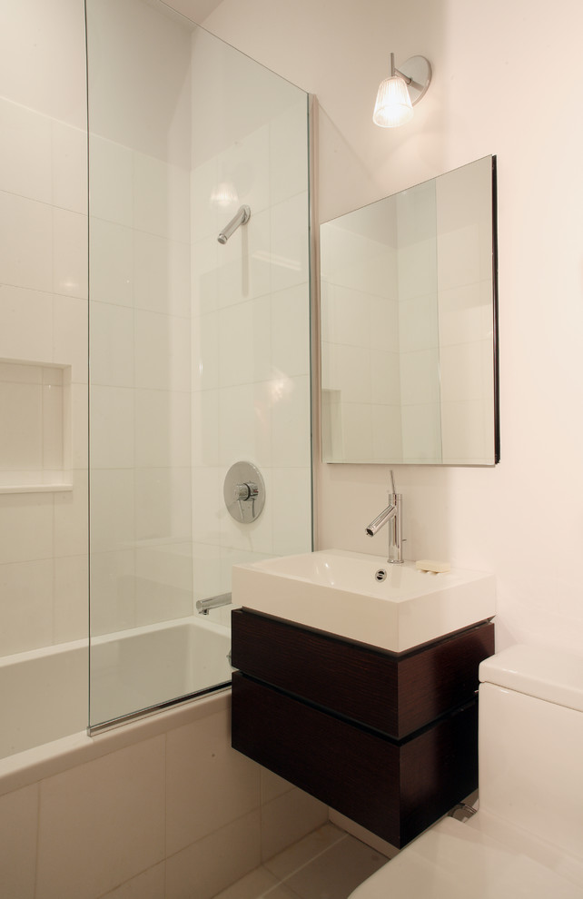 Inspiration for a contemporary bathroom remodel in New York with a wall-mount sink