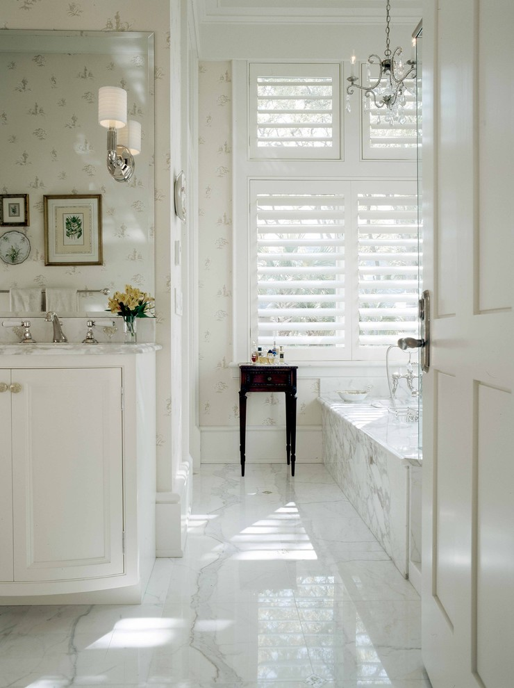 Inspiration for a large timeless master white tile and stone tile marble floor bathroom remodel in Atlanta with beaded inset cabinets, white cabinets, an undermount sink, marble countertops, white walls and white countertops