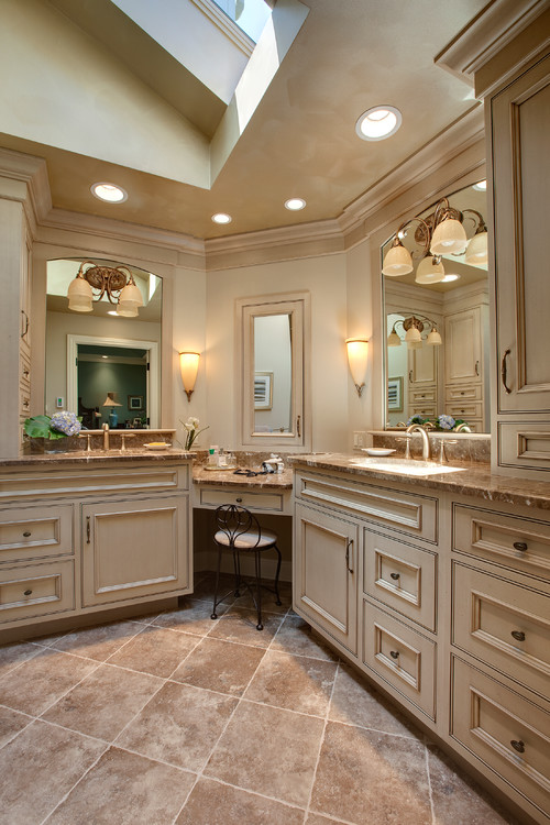 Again, we can see how skylights filter light into a spacious bathroom. This space has layers upon layers of lighting, including sconces, wall lights, and even recessed lighting.