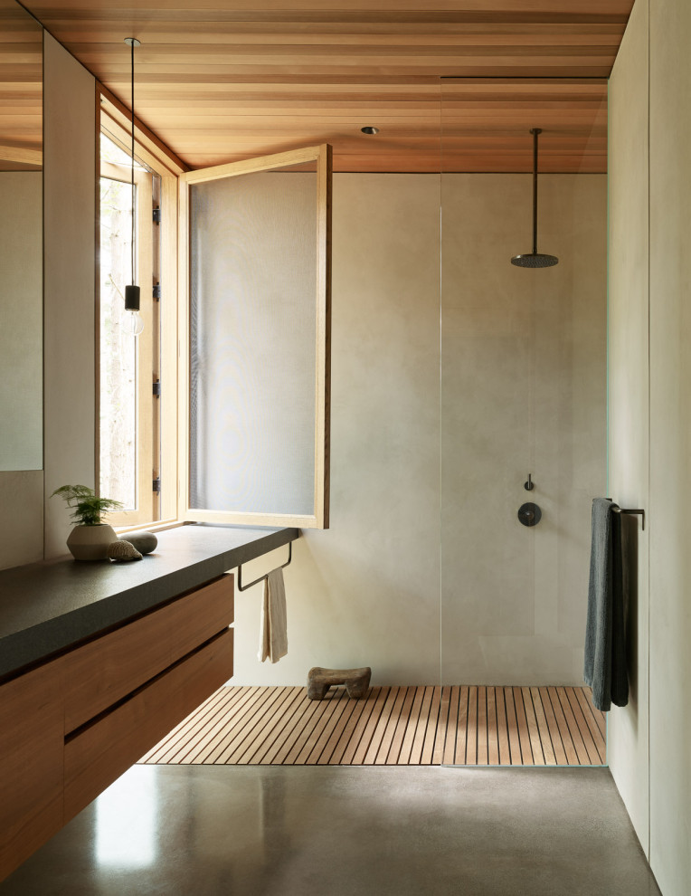 Inspiration for a modern gray tile concrete floor, gray floor and wood ceiling bathroom remodel in Seattle with flat-panel cabinets, granite countertops, medium tone wood cabinets, gray countertops and a floating vanity