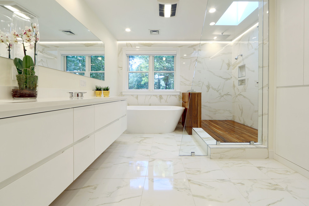 Inspiration for a contemporary master white tile and marble tile marble floor bathroom remodel in Boston with an undermount sink, flat-panel cabinets, white cabinets, solid surface countertops, white walls and white countertops
