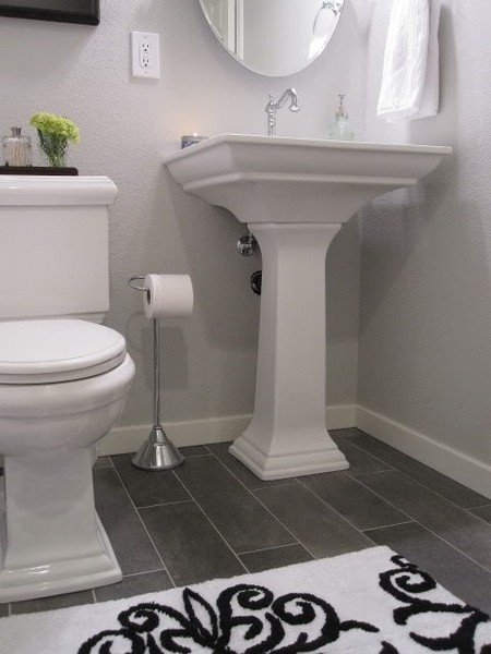 white bath dark floor