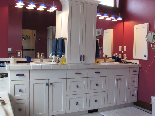 White bathroom vanity with Uneek glass cabinet hardware. contemporary-bathroom