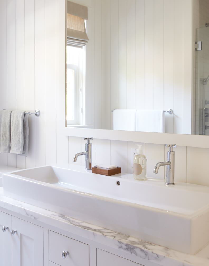 White bathroom with trough sink for two