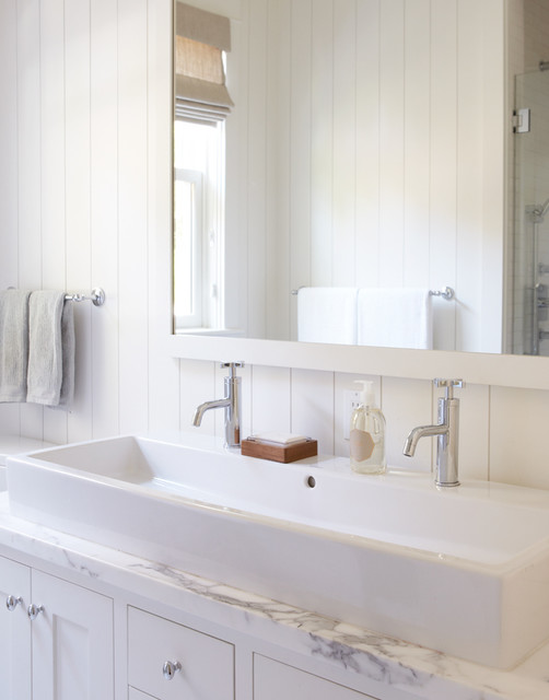 White bathroom with trough sink for two traditional-bathroom