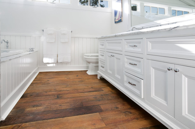 White beach house beach style bathroom orange county for Hardwood floors in bathroom