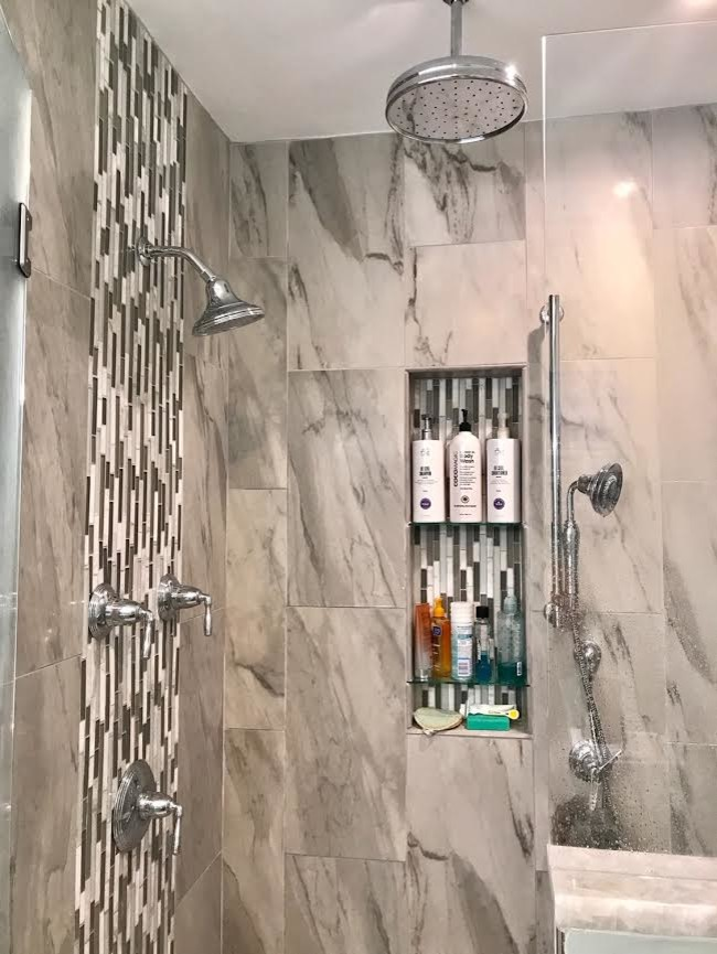 Large trendy master gray tile and porcelain tile medium tone wood floor and brown floor alcove shower photo in Detroit with shaker cabinets, white cabinets, a two-piece toilet, gray walls, a drop-in sink, marble countertops, a hinged shower door and gray countertops