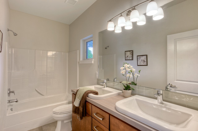 White Contemporary Bathroom With Tiled Tub And His And Hers Sinks Contempor