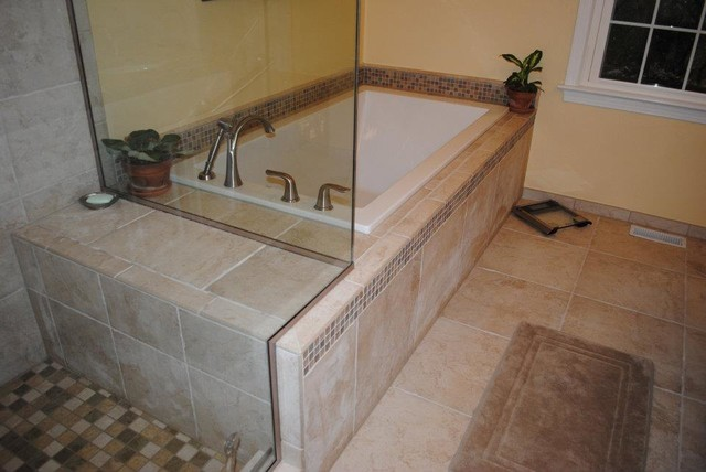 White Drop In Tub, Tile Floor, Tub Surround, And Shower Traditional Bathroom