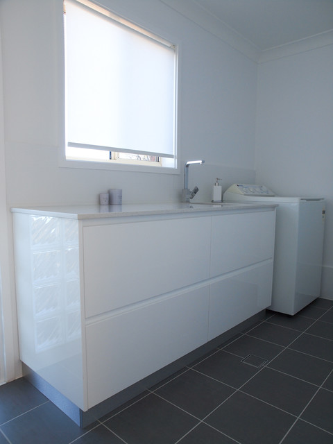 white gloss polyurethane shadowline laundry cabinet with