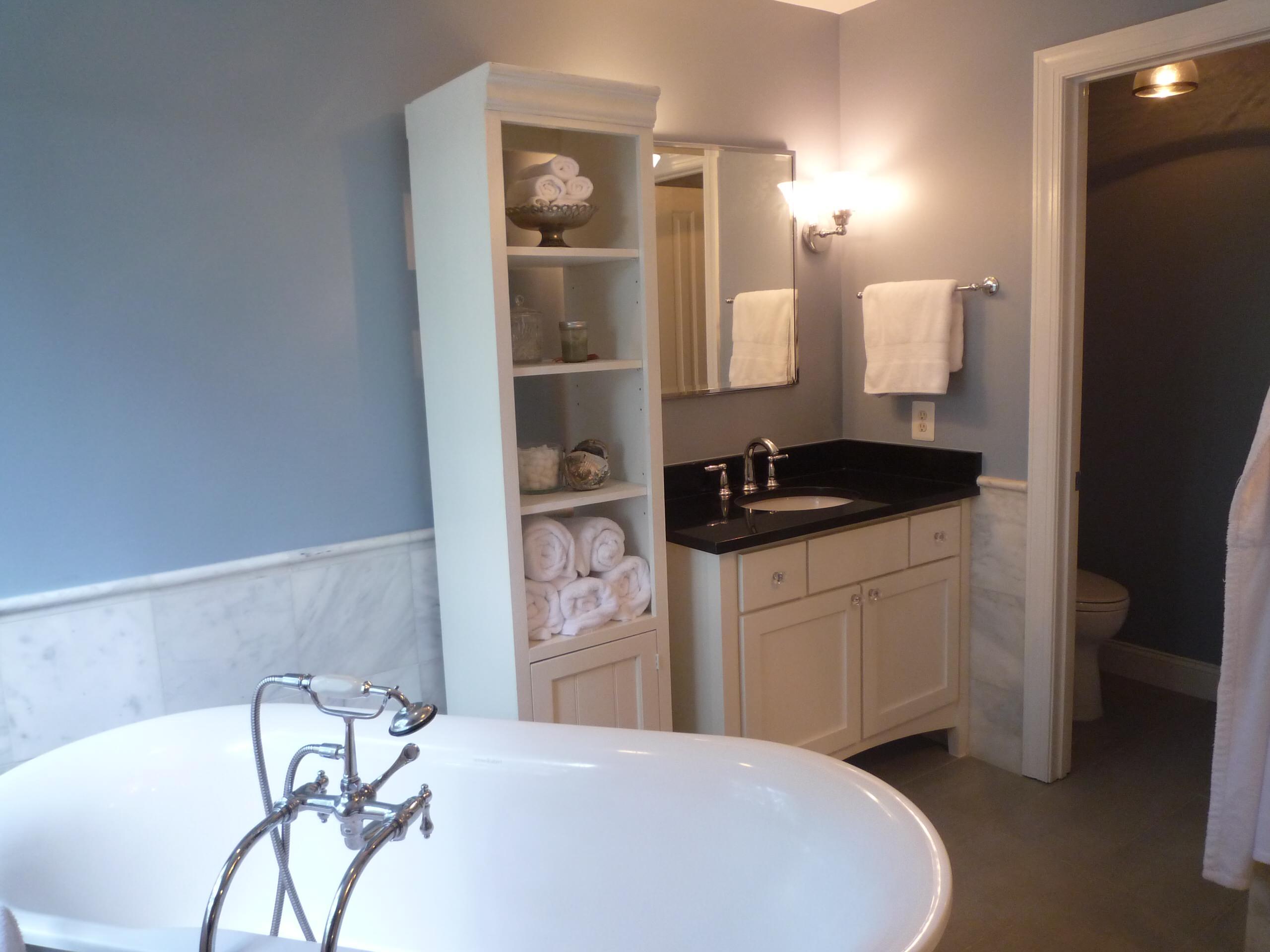 White Marble Blue walls bath in McLean