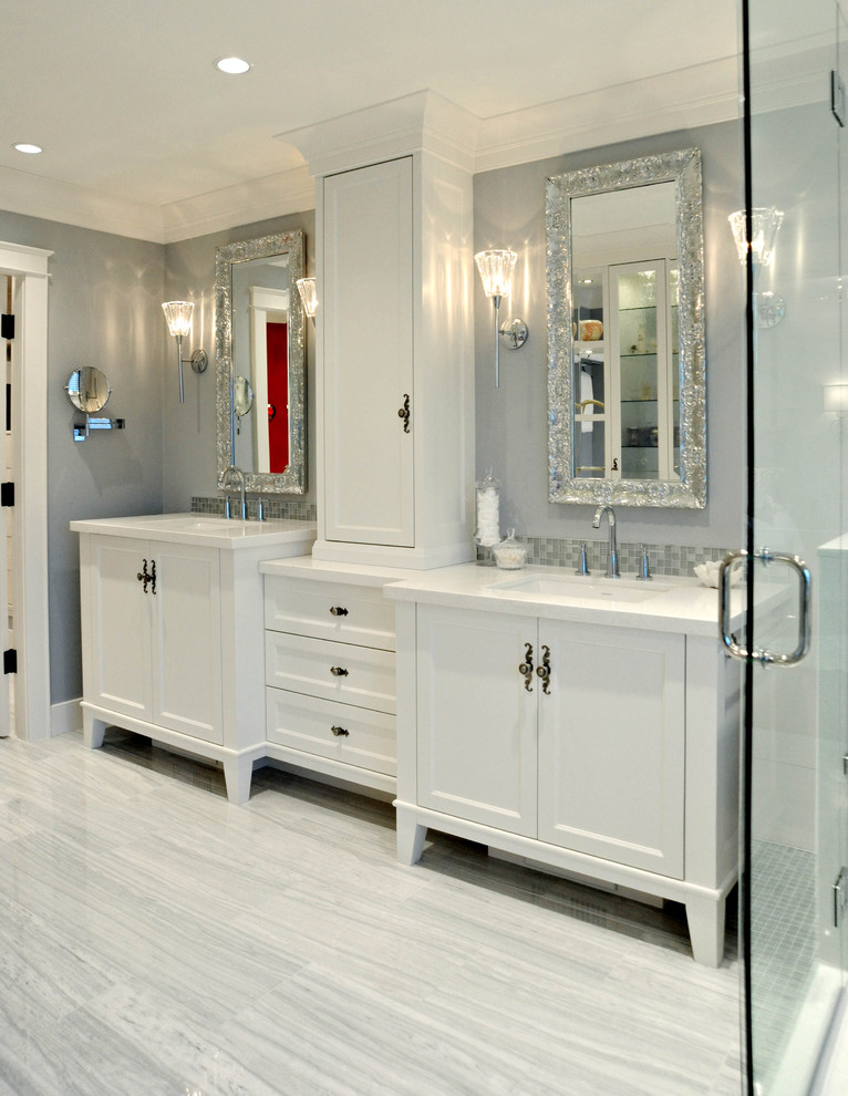 Example of a mid-sized classic master mosaic tile and white tile marble floor freestanding bathtub design in Vancouver with recessed-panel cabinets, white cabinets, quartz countertops, blue walls and an undermount sink
