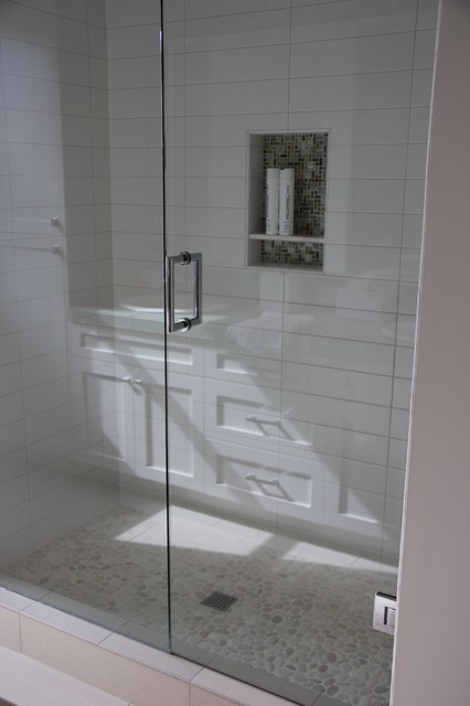 White Shower With Glass Mosaic Niche And Pebble Floor Modern Bathroom New York By