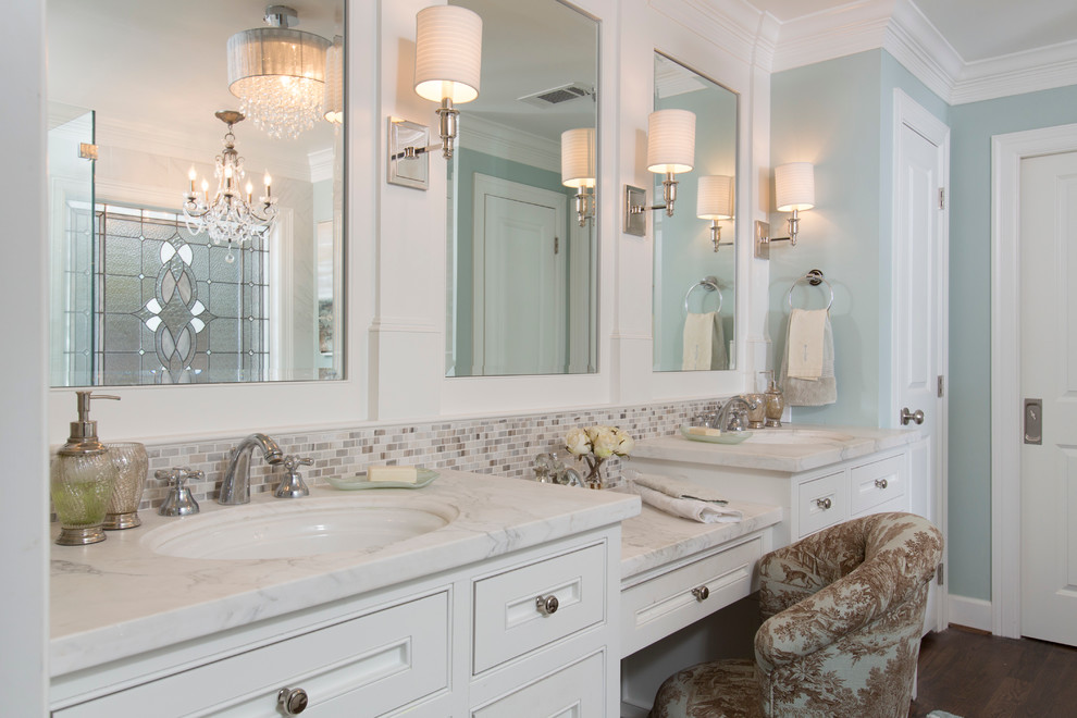Inspiration for a mid-sized timeless master mosaic tile, beige tile and gray tile dark wood floor and brown floor bathroom remodel in Houston with an undermount sink, beaded inset cabinets, white cabinets, blue walls, marble countertops and white countertops