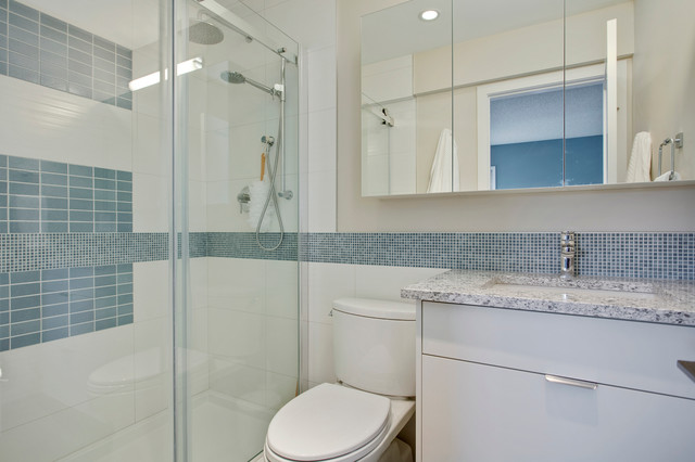 Example of a trendy 3/4 blue tile, white tile and mosaic tile alcove shower design in Calgary with flat-panel cabinets, gray cabinets, beige walls, an undermount sink and granite countertops