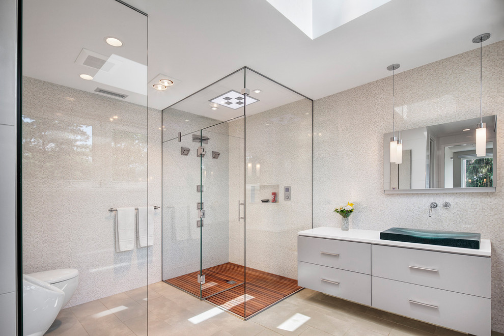 Trendy master white tile and mosaic tile corner shower photo in Chicago with a vessel sink, flat-panel cabinets, white cabinets, a one-piece toilet, white walls, solid surface countertops and a hinged shower door