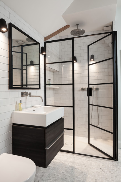 This is an example of a contemporary shower room in Kent with flat-panel cabinets, black cabinets, an alcove shower, a wall mounted toilet, metro tiles, white walls, mosaic tile flooring, a vessel sink, wooden worktops and a hinged door.