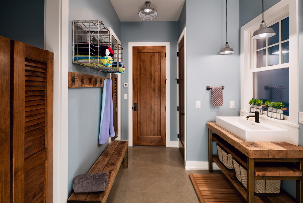 Cottage bathroom photo in Chicago with open cabinets, dark wood cabinets, blue walls and wood countertops