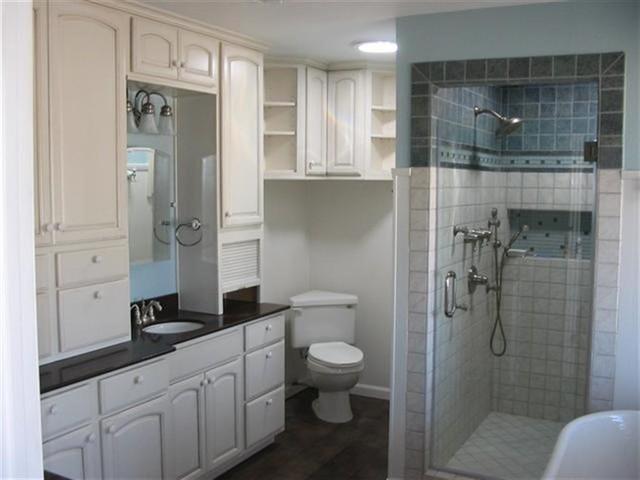 Wood plank porcelain tile, body sprays, shower styles, tile patterns  traditional-bathroom