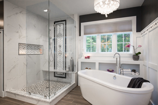 Photo of a large traditional ensuite bathroom in Manchester with a freestanding bath, a walk-in shower, white tiles, stone tiles, black walls, dark hardwood flooring, a submerged sink and an open shower.