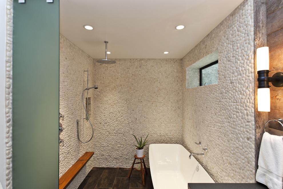 Trendy pebble tile freestanding bathtub photo in San Francisco