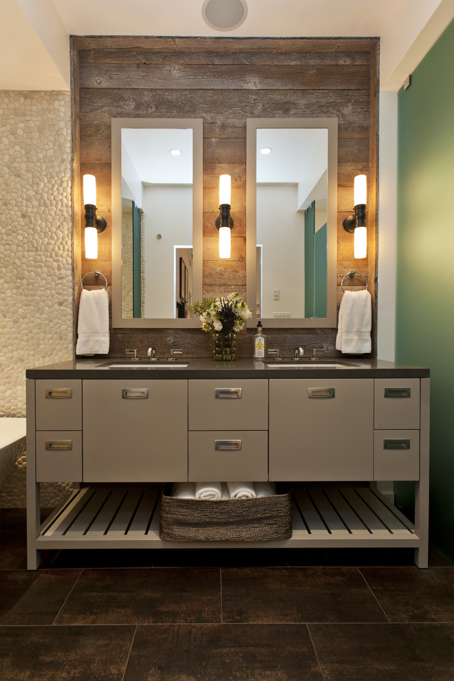 Example of a trendy beige tile and pebble tile bathroom design in San Francisco with an undermount sink, gray cabinets and flat-panel cabinets