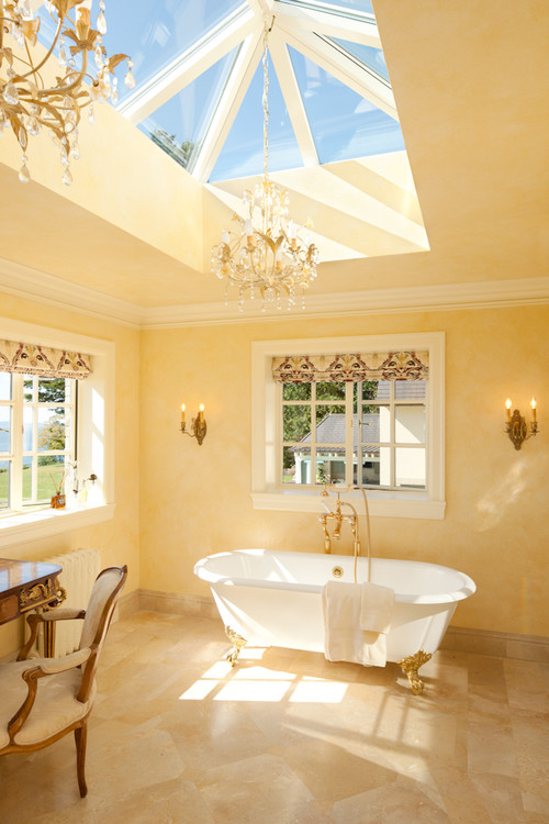 Natural light pours through large windows in this master bath.