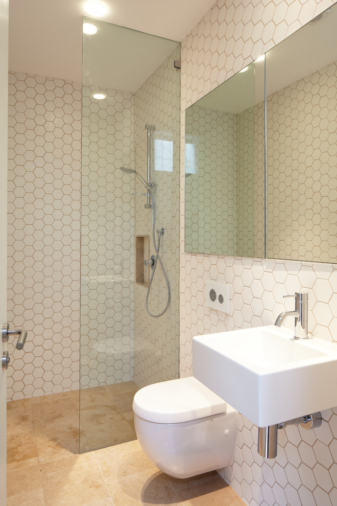 Mid-sized trendy master white tile and ceramic tile ceramic floor walk-in shower photo in Sydney with a wall-mount sink, flat-panel cabinets, a wall-mount toilet and white walls