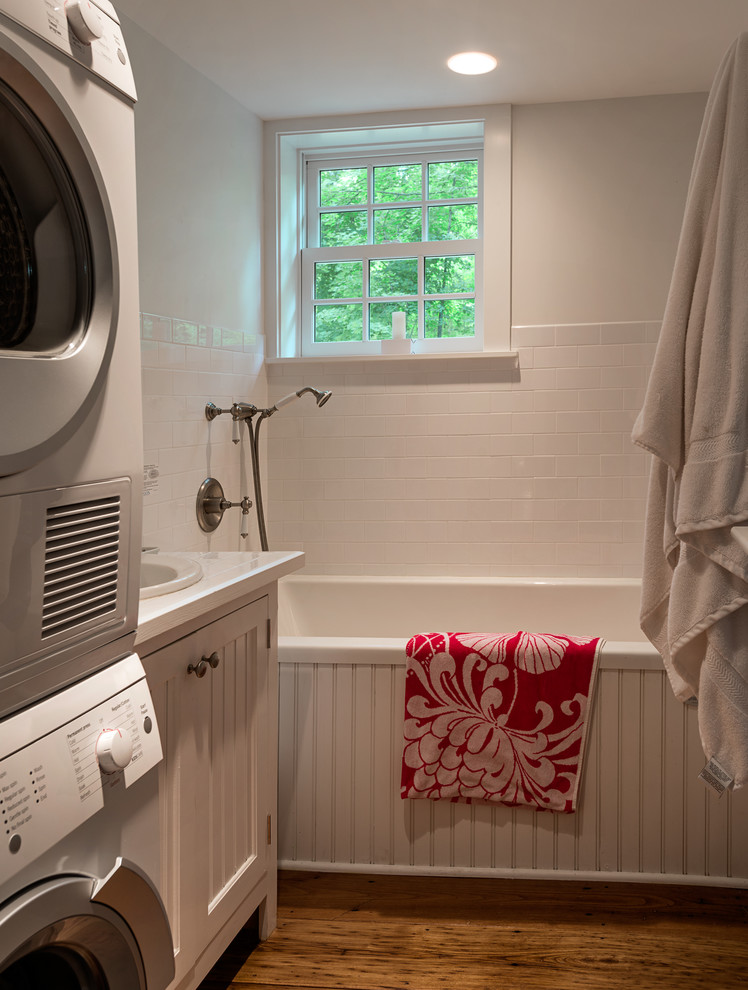 Elegant bathroom/laundry room photo in New York with a drop-in sink