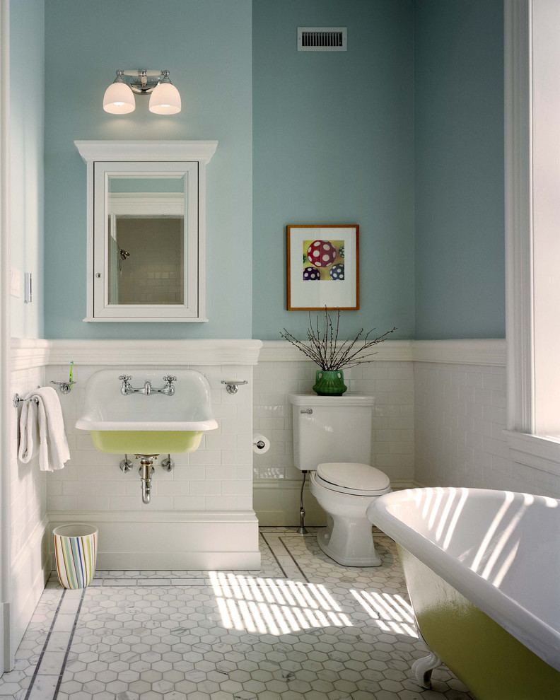 Elegant kids' subway tile claw-foot bathtub photo in Philadelphia with a wall-mount sink and blue walls